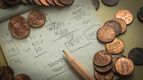 One cent coins place on scrap paper Stock Photography
