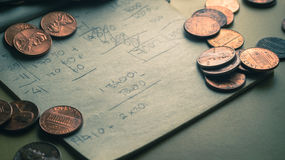 One cent coins place on scrap paper Royalty Free Stock Photos