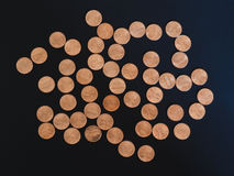 One Cent Dollar coins, United States over black Royalty Free Stock Image