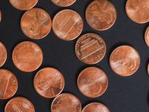 One Cent Dollar coins, United States over black Royalty Free Stock Photography