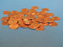 One Cent Dollar coins, United States over blue Stock Images