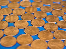 One Cent Dollar coins, United States over blue Stock Photo