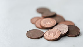 One cent Euro coins. Some one cent euro coins macro shot on a white textured background Stock Photo