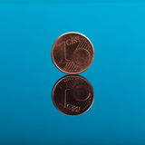One cent, Euro money coin on blue with reflection Stock Image