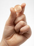 One cent in a hand. The children's hand holds a coin in one cent Royalty Free Stock Image