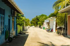 One of the central streets of small tropical island, overlooking the Indies Ocean, Kaafu Atoll, Kuda Huraa Island, Maldives. Huraa, Maldives - November 20, 2017 Stock Images
