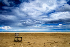 One chair on the beach Stock Images