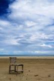 One chair on the beach stock photos