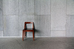 One chair at the wall Royalty Free Stock Image