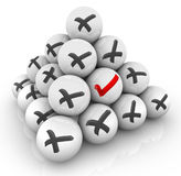 One Check Mark Ball Pyramid X Marks Positive Vs Negative Answer. A single ball with a red check mark in a pyramid of spheres with black x marks to illustrate Stock Photography