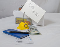 One checkbook, pen and bills to pay Royalty Free Stock Photography