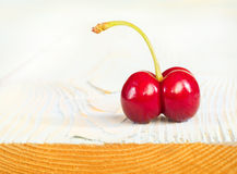 One cherry on old wood Stock Photo