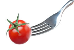 One cherry tomato on a fork over white Stock Photography