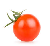 One cherry tomato on a white background. Closeup Royalty Free Stock Images