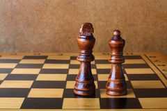 One chess king dominating another Royalty Free Stock Images