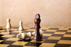 One chess king dominating another Stock Photography
