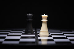 One  chess pieces staying against black chess pieces Royalty Free Stock Photography
