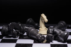 One  chess pieces staying against black chess pieces Stock Images