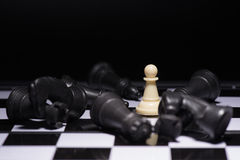 One  chess pieces staying against black chess pieces Royalty Free Stock Images