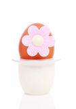 One chicken egg with pink flower in holder Stock Photography