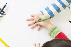 One child draws the around the hand of another royalty free stock photo