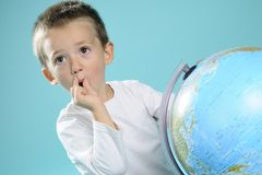 One child evaluating destinations on globe Stock Photography
