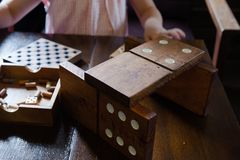 Jiant dominoes on the wooden table royalty free stock images
