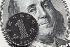 One chinese coin yuan and one hundred dollar bill. Global economics concept : chinese and american currency together. Focus on coin royalty free stock photos