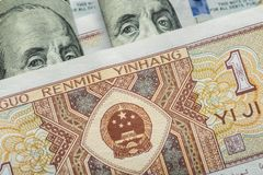 One Chinese yuan banknote onto various us dollar. Usa Royalty Free Stock Photo