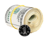 One chinese yuan coin versus bundle of US dollars Royalty Free Stock Image