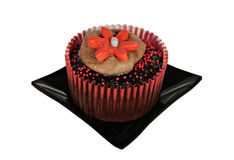One chocolate cupcake with red icing Royalty Free Stock Image