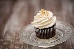 One Chocolate Cupcake With Vanilla Frosting On Glass Plate Stock Photos