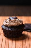 One chocolate muffin suffed with sweet creamy haze Royalty Free Stock Image
