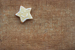 One christmas cookie on the flax texture Royalty Free Stock Photo