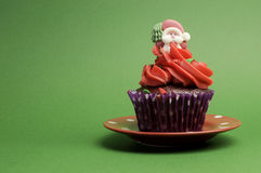 One Christmas Cupcake against a green background - horizontal. Royalty Free Stock Images