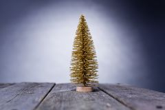 One christmas tree on wooden with grey background. Christmas tree golden decoration on rustic wooden royalty free stock images