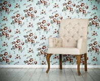 One classic armchair against a wall and floor Royalty Free Stock Photo