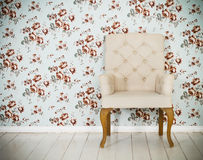One classic armchair against a wall and floor Royalty Free Stock Photography