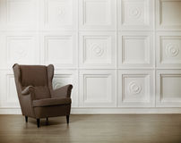One classic armchair against a white wall and floor Royalty Free Stock Image