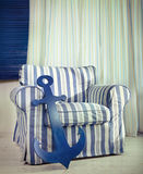 One classic armchair against a white wall and floor Royalty Free Stock Photos