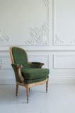 One classic armchair against a white wall and floor. Copy space Royalty Free Stock Photography