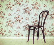 One classic chair against a wall and floor Royalty Free Stock Images