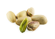 One cleared kernel. Pistachios and one cleared kernel on white background Royalty Free Stock Photo