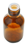 One closed amber glass oval pharmacy bottle Royalty Free Stock Images
