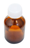 One closed brown glass oval pharmacy bottle Royalty Free Stock Images