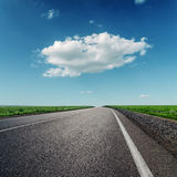 One cloud and asphalt road Stock Images