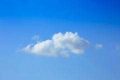 One cloud on clear blue sky Stock Image