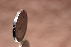 One coin. On the single lens reflex Royalty Free Stock Image