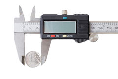 One coin measured with a caliper Royalty Free Stock Photography