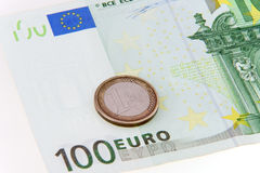 One coin saving hundred euro - concept. One euro coin let saving hundred euro - concept shot Royalty Free Stock Images